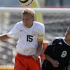 Jeff Krage – For Shaw Media<br /> St. Charles East's Kevin Heinrich heads the ball away from Streamwood's Ivan Leyva during Saturday's game at St. Charles East High School.<br /> St. Charles 9/28/13