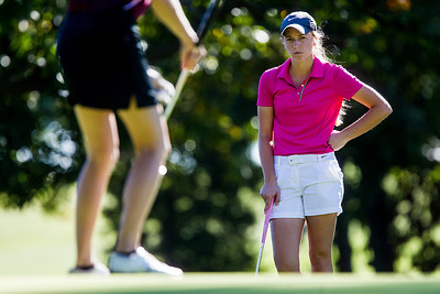 Kyle Grillot - kgrillot@shawmedia.com   Crystal Lake Central's Bailey Bostler watches as Prairie Ridge's Anne Schulz putts the ball on the second hole during the Fox Valley Conference girls golf tournament at Crystal Woods golf course Wednesday, October 2, 2013.