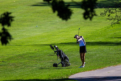 Kyle Grillot - kgrillot@shawmedia.com   Huntley's Zoe Dowell hits her ball from the fairway on the second hole during the Fox Valley Conference girls golf tournament at Crystal Woods golf course Wednesday, October 2, 2013.