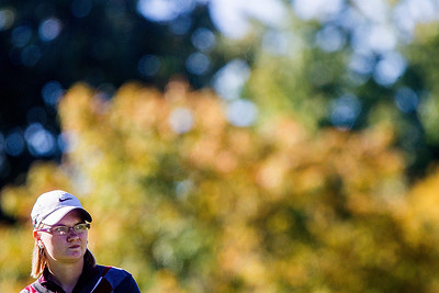 Kyle Grillot - kgrillot@shawmedia.com   Prairie Ridge's Brook Johnson watches her ball after teeing off on the first hole during the Fox Valley Conference girls golf tournament at Crystal Woods golf course Wednesday, October 2, 2013.
