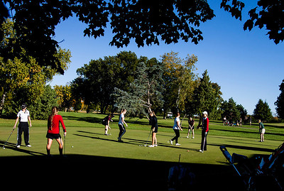 Kyle Grillot - kgrillot@shawmedia.com   Players warm up on the putting green before the start of the Fox Valley Conference girls golf tournament at Crystal Woods golf course Wednesday, October 2, 2013.