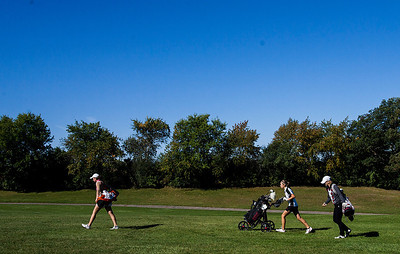 Kyle Grillot - kgrillot@shawmedia.com   Crystal Lake Central's Lexi Harkins (left), Huntley's Gillian Young (center) and Prairie Ridge's Brook Johnson advance after teeing off on the the third hole during the Fox Valley Conference girls golf tournament at Crystal Woods golf course Wednesday, October 2, 2013.