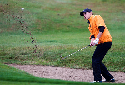 Kyle Grillot - kgrillot@shawmedia.com   Woodstock's Alex Ferguson chips his ball out of a bunker on the third hole during the Fox Valley Conference boys golf tournament at Golf Club of Illinois Thursday, October 3, 2013.