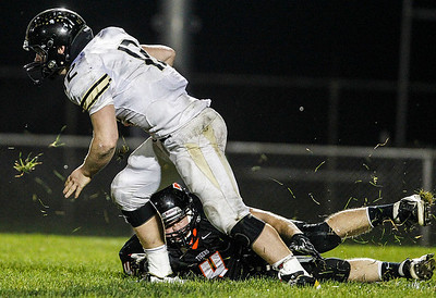 Kyle Grillot - kgrillot@shawmedia.com   Grayslake North sophomore Merrick Gentile escapes Cyrstal Lake Central Nathan Talbott's (4) failed tackle attempt during the third quarter of the high school football game against Grayslake North Friday, October 4, 2013.