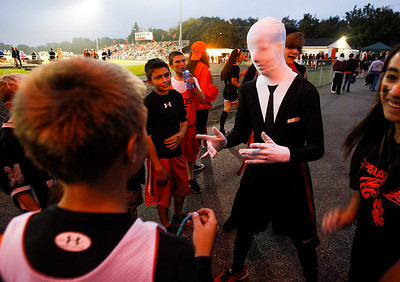 Kyle Grillot - kgrillot@shawmedia.com   Crystal Lake Central sophomore Austin Vance dressed up for the homecoming game entertains younger kids before the start of the high school football game against Grayslake North Friday, October 4, 2013.