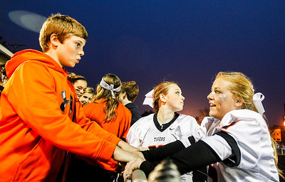 Kyle Grillot - kgrillot@shawmedia.com   Seamus O'Donnell (left) talks with his sister Crystal Lake senior Mary O'Donnell (center) and Hannah Matousek  before the start of the high school football game against Grayslake North Friday, October 4, 2013.