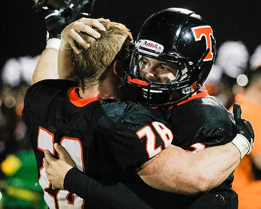 Kyle Grillot - kgrillot@shawmedia.com   Crystal Lake Central seniors Kyle Lavand (right) and Connor Hines celebrates after the final play of the high school football game against Grayslake North Friday, October 4, 2013.