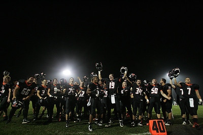 Kyle Grillot - kgrillot@shawmedia.com   The Cyrstal Lake Central team celebrates after the final play of the high school football game against Grayslake North Friday, October 4, 2013.