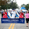Members of the Geneva High School marching band play the school song while marching on State Street for the school's annual homecoming parade Friday afternoon.