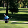 St. Charles North's Raghav Cherala chips onto the green during the Upstate Eight Conference Tournament at St. Andrews Golf Club in West Chicago Wednesday morning.