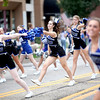 Members of the Geneva High School pom squad perform on State Street for the school's annual homecoming parade Friday afternoon.