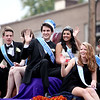 (Left to right) Geneva High School senior attendants Ryan Schneider and Jennifer Feutz, King Kevin McCarthy, Queen Sabrina Jaffer, Princess Hope Goodman and Prince Quinn Einck ride atop a float during the school's annual homecoming parade on State Street Friday afternoon.