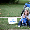Lyndsey McCue and her son, Declan, 11 months, watch the Geneva High School homecoming parade on State Street Friday afternoon.