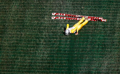 Kyle Grillot - kgrillot@shawmedia.com   Karl Schultz slowly gets up after falling during the 28th annual Autumn Ski Jump competition Sunday at the Norge Ski Club in Fox River Grove.