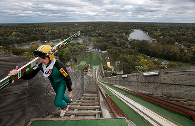 Kyle Grillot - kgrillot@shawmedia.com   Adam Hamler walks up the stairs to the top of the 150-foot platform before jumping during the 28th annual Autumn Ski Jump competition Sunday at the Norge Ski Club in Fox River Grove.