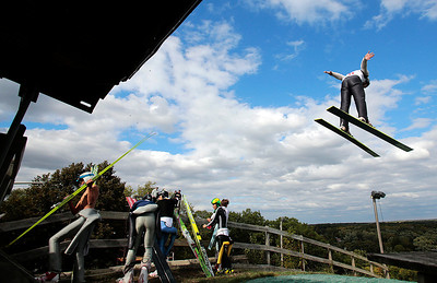 Kyle Grillot - kgrillot@shawmedia.com   Patrick Gasienica of the Norge Ski Club flies past competitors during the 28th annual Autumn Ski Jump competition Sunday at the Norge Ski Club in Fox River Grove.