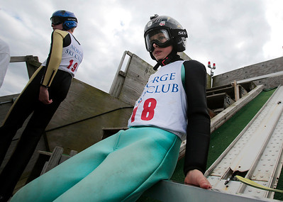 Kyle Grillot - kgrillot@shawmedia.com   Lucas Nichols, 12, waits at the top of the platform before jumping during the 28th annual Autumn Ski Jump competition Sunday at the Norge Ski Club in Fox River Grove.