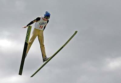Kyle Grillot - kgrillot@shawmedia.com   Ryan Johnson of St. Paul, Minn. jumps during the 28th annual Autumn Ski Jump competition Sunday at the Norge Ski Club in Fox River Grove.
