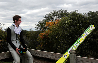 Kyle Grillot - kgrillot@shawmedia.com   Tucker Hoefler waits at the top of the hill before it is his turn to jump during the 28th annual Autumn Ski Jump competition Sunday at the Norge Ski Club in Fox River Grove.