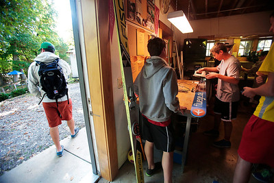 Kyle Grillot - kgrillot@shawmedia.com   Casey Larson of Barrington (right) waxes his skis before the start of the 28th annual Autumn Ski Jump competition Sunday at the Norge Ski Club in Fox River Grove.