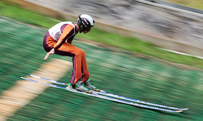 Kyle Grillot - kgrillot@shawmedia.com   Norge Ski Club's Ben Kaiser fights to keep control as he lands a jump during the 28th annual Autumn Ski Jump competition Sunday at the Norge Ski Club in Fox River Grove.