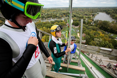 Kyle Grillot - kgrillot@shawmedia.com   Tucker Hoefler, Adam Hamler, and Landon Liveri wait their turn at the top of the ski hill platform during the 28th annual Autumn Ski Jump competition Sunday at the Norge Ski Club in Fox River Grove.