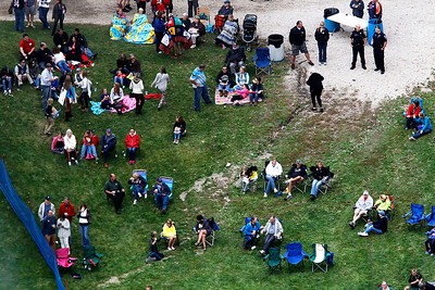 Kyle Grillot - kgrillot@shawmedia.com   Spectators watch jumpers from the bottom of the hill during  the 28th annual Autumn Ski Jump competition Sunday at the Norge Ski Club in Fox River Grove.