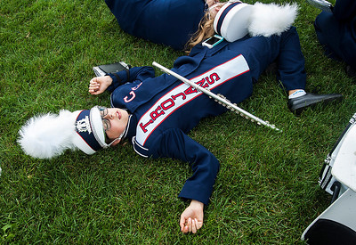 Kyle Grillot - kgrillot@shawmedia.com   Cary-Grove junior Amanda Heggem takes a moment to rest before the half time show during the high school football game against McHenry Saturday, October 5, 2013.