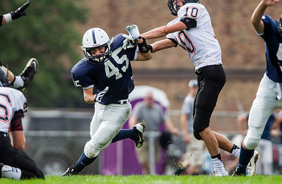 Kyle Grillot - kgrillot@shawmedia.com   Cary-Grove junior Thomas Emma (45) attempts to block an extra point during the fourth quarter of the high school football game Saturday, October 5, 2013.