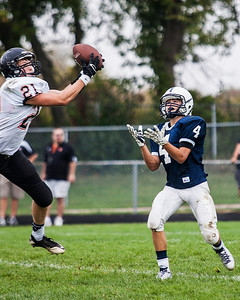 Kyle Grillot - kgrillot@shawmedia.com   McHenry junior Scott Marunde nearly intercepts a ball intended for Cary Grove junior Larkin Hanselmann during the second quarter of the high school football game against McHenry Saturday, October 5, 2013.