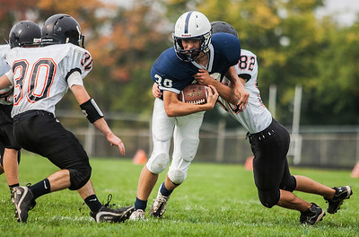 Kyle Grillot - kgrillot@shawmedia.com   Cary-Grove junior Thor Halverson (30) is tackled by McHenry junior Jarrod Jablonski during the fourth quarter of the high school football game Saturday, October 5, 2013.