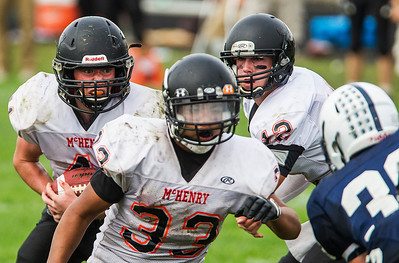 Kyle Grillot - kgrillot@shawmedia.com   McHenry senior Thomas Hellios carries the ball during the fourth quarter of the high school football game against Cary Grove Saturday, October 5, 2013.
