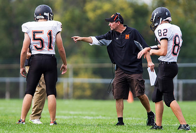 Kyle Grillot - kgrillot@shawmedia.com   McHenry head coach Dave D'Angelo talks with his players during the fourth quarter of the high school football game Saturday, October 5, 2013.