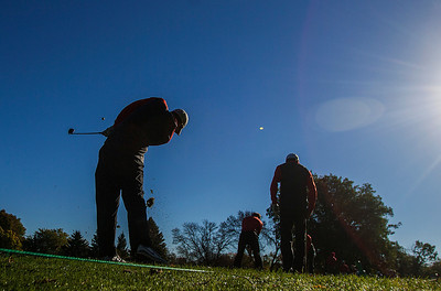 Kyle Grillot - kgrillot@shawmedia.com   Competitors warm up before the start of the Woodstock North Class 3A regional boys golf tournament at Plum Tree National Golf Club Tuesday, October 8, 2013.