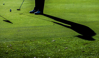 Kyle Grillot - kgrillot@shawmedia.com   A golfer warms up on the putting green before the start of the Woodstock North Class 3A regional boys golf tournament at Plum Tree National Golf Club Tuesday, October 8, 2013.