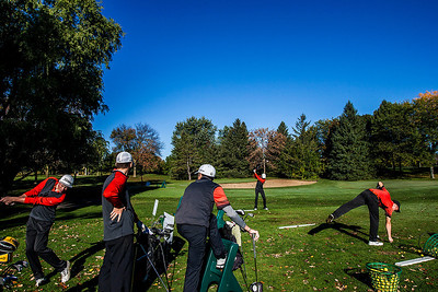 Kyle Grillot - kgrillot@shawmedia.com   The Crystal Lake Central team warms up before the start of the Woodstock North Class 3A regional boys golf tournament at Plum Tree National Golf Club Tuesday, October 8, 2013.