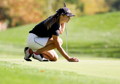 Sarah Nader- snader@shawmedia.com St. Charles North's Carly Hudon prepares her putt during the Class AA Prairie Ridge Girls Golf Regional in Crystal Lake Wedensday, October 9, 2013.