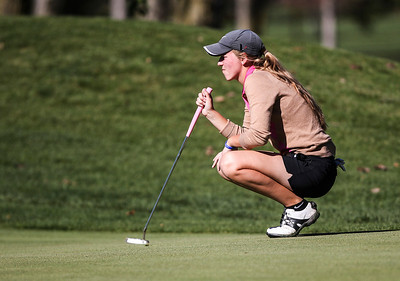 Sarah Nader- snader@shawmedia.com Crystal Lake Central's co-op's  Bailey Bostler prepares to putt at hole two during the Class AA Prairie Ridge Girls Golf Regional in Crystal Lake Wedensday, October 9, 2013.