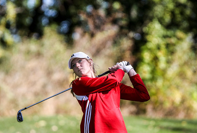 Sarah Nader- snader@shawmedia.com Barrington's Bailee McDonald watches her ball after teeing off on the fifth hole during the Class AA Prairie Ridge Girls Golf Regional in Crystal Lake Wedensday, October 9, 2013.