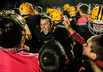 Kyle Grillot - kgrillot@shawmedia.com   Jacobs fans rush the field to celebrate with football players after their win against Cary-Grove Friday October 11, 2013. Jacobs won the game 36-35.