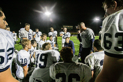 Kyle Grillot - kgrillot@shawmedia.com   Cary-Grove head coach Brad Seaburg talks with his team during half time of the high school football game against Jacobs Friday October 11, 2013. Jacobs won the game 36-35.