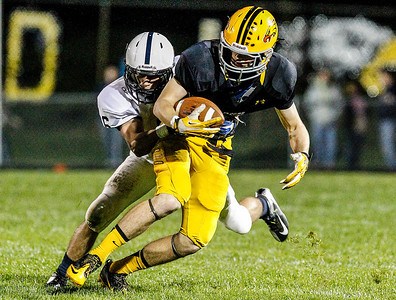 Kyle Grillot - kgrillot@shawmedia.com   Jacobs junior Camden McLain is tackled by Cary-Grove senior Kevin Fisher during the second quarter of the high school football game against Cary-Grove Friday October 11, 2013. Jacobs won the game 36-35.