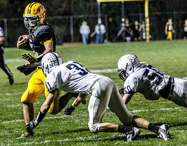 Senior Bret Mooney is tackled out of bounds by the Cary-Grove defense during the fourth quarter of the high school football game against Cary-Grove Friday October 11, 2013. Jacobs won the game 36-35.   Kyle Grillot - kgrillot@shawmedia.com