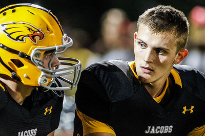 Kyle Grillot - kgrillot@shawmedia.com   Senior Bret Mooney talks with senior Hunter Williams quarter of the high school football game against Cary-Grove Friday October 11, 2013. Jacobs won the game 36-35.