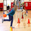 "Fabyan Elementary School fifth-grader Cari Barr bowls on one leg for ""wacky bowling,"" which concluded the Geneva school's bowling curriculum. Physical education teacher Mike Graham received a $1,200 grant for six lanes of indoor bowling."