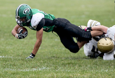 Sarah Nader- snader@shawmedia.com Alden-Hebron's Nate Peterson is tackled during the first quarter of Saturday's football game against Hiawatha in Hebron October 12, 2013. Alden-Hebron won, 28-8.
