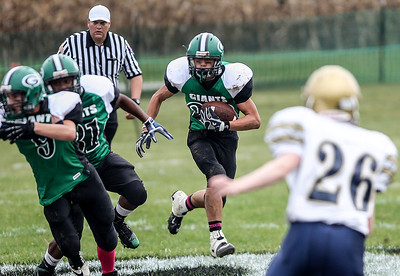 Sarah Nader- snader@shawmedia.com Alden-Hebron's Nate Peterson runs the ball during the first quarter of Saturday's football game against Hiawatha in Hebron October 12, 2013. Alden-Hebron won, 28-8.