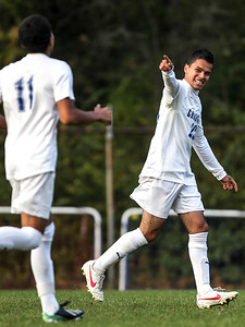 Sarah Nader- snader@shawmedia.com Dundee-Crown's Gerardo Escorza celebrates his goal during the first half of Tuesday's FVC Valley match against Jacobs in Carpentersville October 15, 2013. Dundee-Crown defeated Jacobs, 5-0 and finished their regular season 19-0-1.