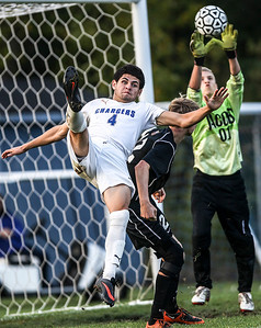 Sarah Nader- snader@shawmedia.com Dundee-Crown's Eduardo Arellano takes a shot during Tuesday's FVC Valley match against Jacobs in Carpentersville October 15, 2013. Dundee-Crown defeated Jacobs, 5-0 and finished their regular season 19-0-1.