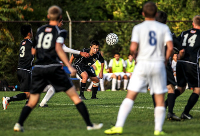Sarah Nader- snader@shawmedia.com Jacobs' Nick Voss heads the ball during the first half of Tuesday's FVC Valley match against Dundee-Crown in Carpentersville October 15, 2013. Dundee-Crown defeated Jacobs, 5-0 and finished their regular season 19-0-1.